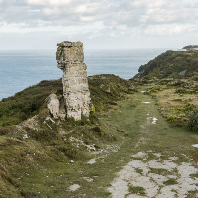 """Nicodemus Knob, 30-feet pillar of Portland stone, left as a landmark and quarrying relic, jurassic coast, Dorset, Uk."" stock image"