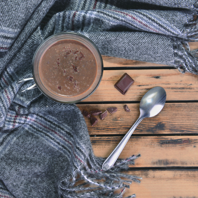 """""""top view on a mug of hot chocolate with scarf on a wooden table"""" stock image"""