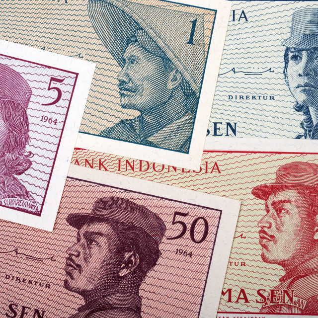 """Old Indonesian money a background"" stock image"