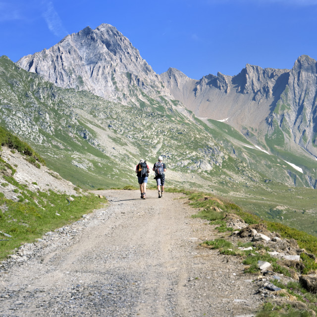 """""""beautiful mountain landscape with hikers walking on a hiking trail"""" stock image"""