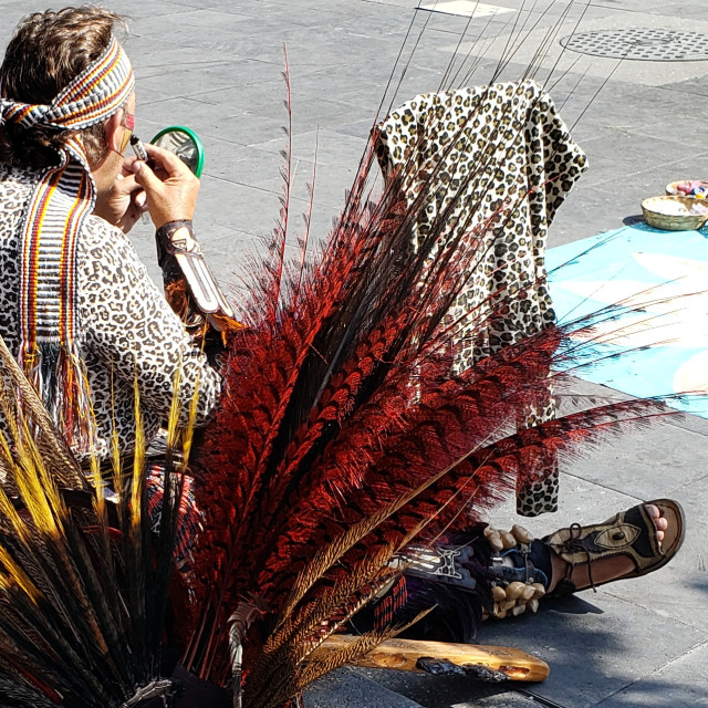 """""""An indigenous performer applies make-up in the Zocalo, Mexico City"""" stock image"""