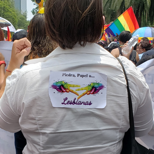 """""""A woman wears a sticker on her jacket at the Pride parade in Mexico City, Mexico"""" stock image"""