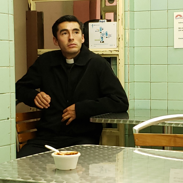 """""""A priest waits for his food in a restaurant, Mexico City, Mexico"""" stock image"""