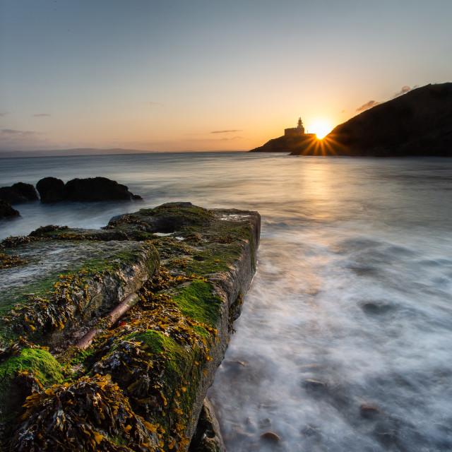"""""""Mumbles lighthouse sunrise"""" stock image"""