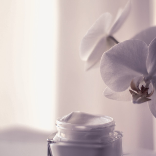 """Face cream moisturizer jar and orchid flower, moisturizing skin care lotion..."" stock image"