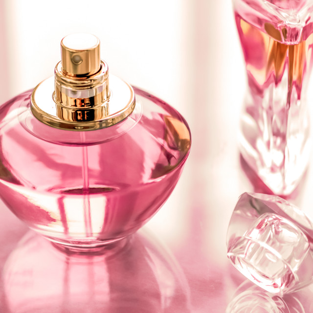 """Pink perfume bottle on glossy background, sweet floral scent, glamour..."" stock image"
