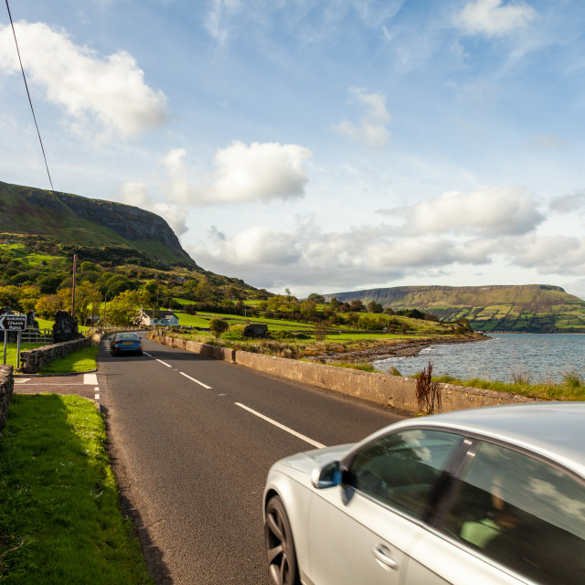 """""""Antrim Coast Road at Ardclinis Church between Carnlough and Waterfoot"""" stock image"""