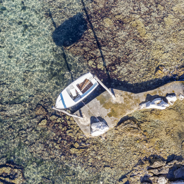 """""""An aerial view of coastline and hanging boat in Umag, Istria, Croatia"""" stock image"""