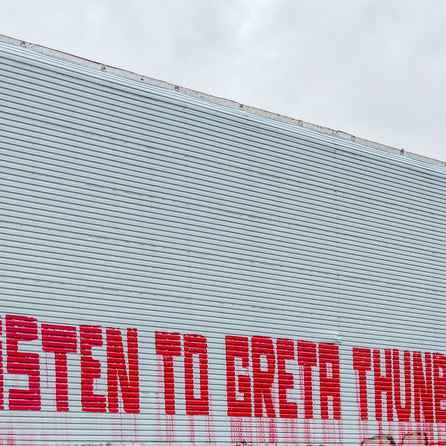 """""""Listen to Greta Thunberg, a text message on a wall in Copenhagen"""" stock image"""
