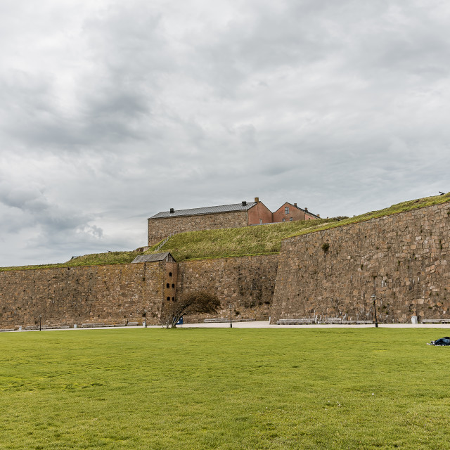 """""""The fortress of Varberg and a boy and a girl are resting on the"""" stock image"""