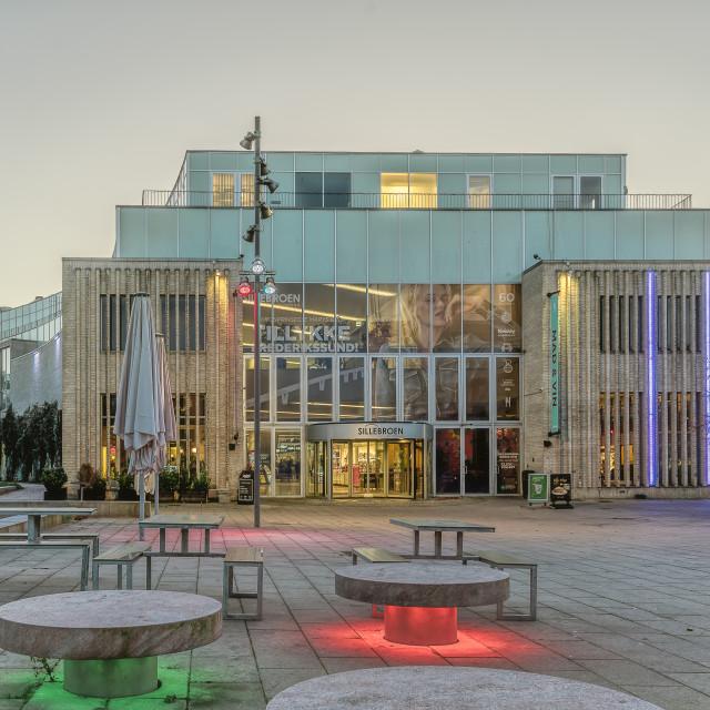 """The facade of Sillebroen, a colourful Shopping center in the eve"" stock image"