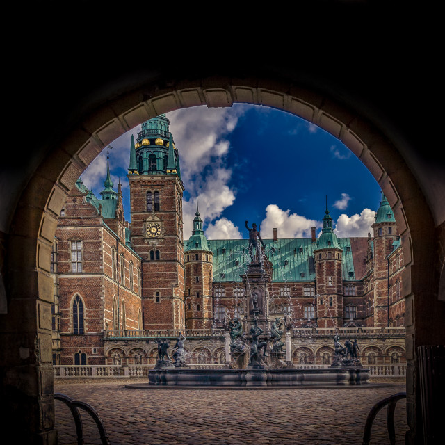 """Archway through the dark gate to Frederiksborg castle"" stock image"