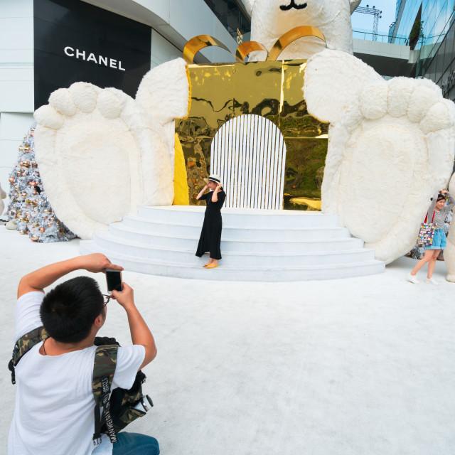 """People enjoying the Christmas decorations and giant polar bears"" stock image"