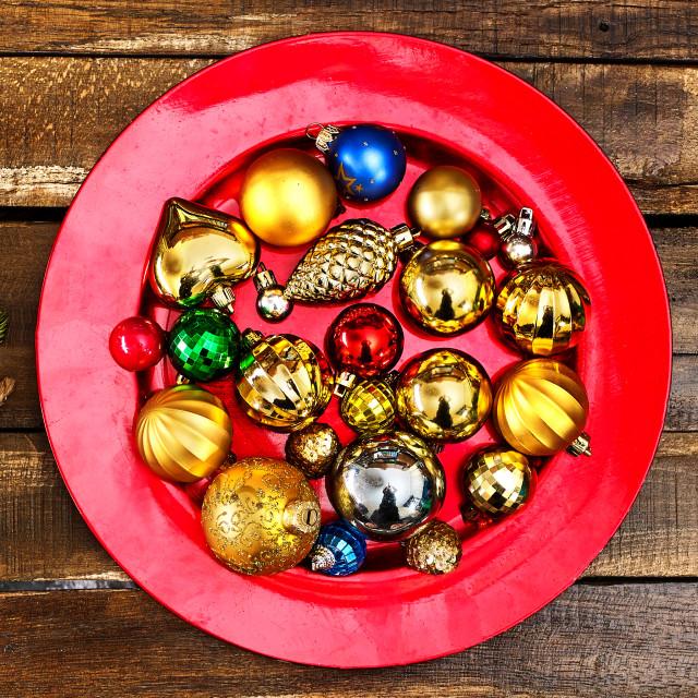 """Christmas balls ornaments on red plate. Horizontal long frame."" stock image"