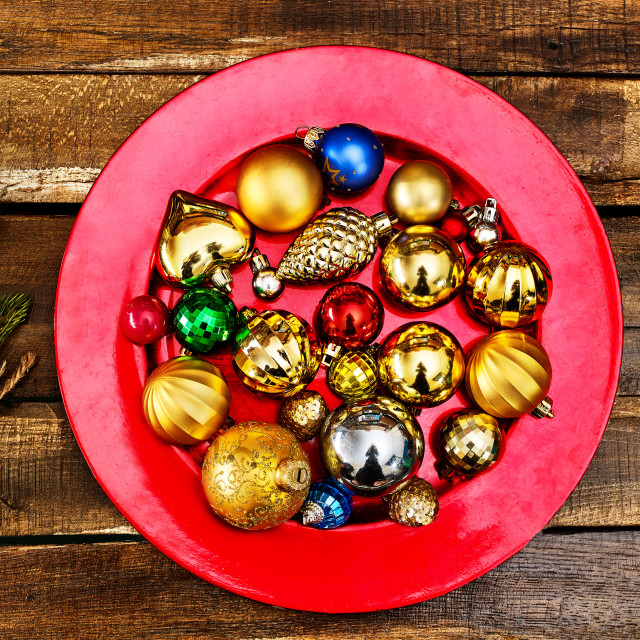 """""""Christmas decorations design of Xmas balls ornaments on red plate"""" stock image"""