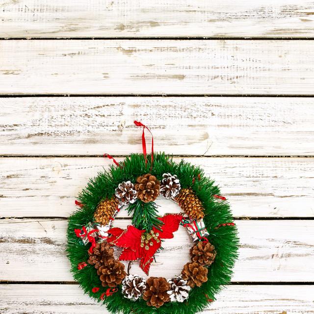 """Christmas wreath decoration hangs on front door vertical frame"" stock image"