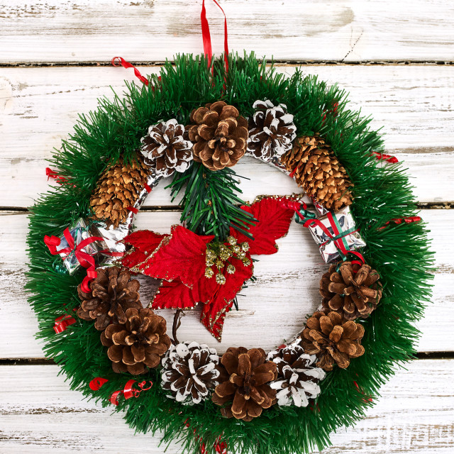 """Christmas wreath decoration hangs on front door"" stock image"
