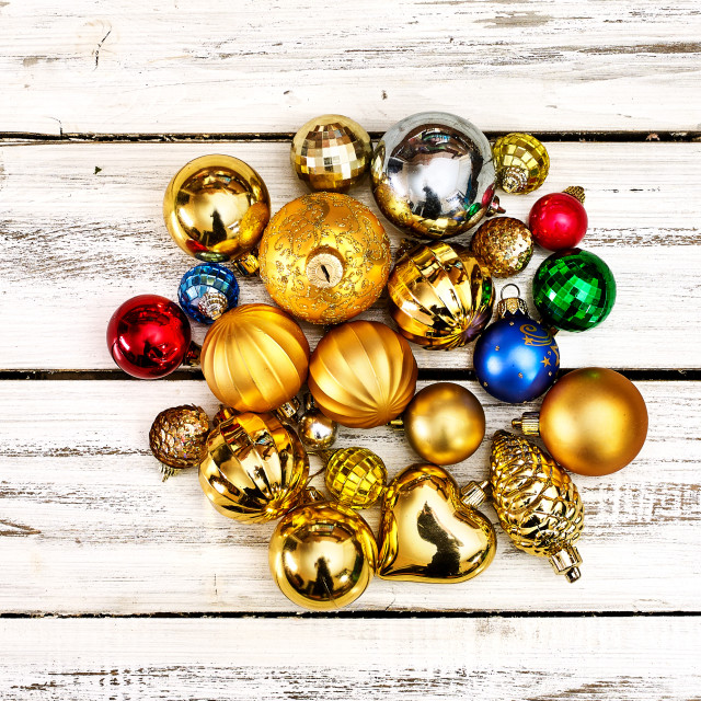 """Christmas stack of Xmas balls decorations on white wooden boards"" stock image"