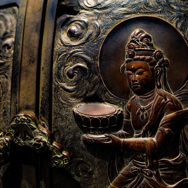 """Buddhist Figures on an Incense Burner in Japan"" stock image"