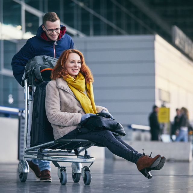 """Cheerful couple travel together"" stock image"