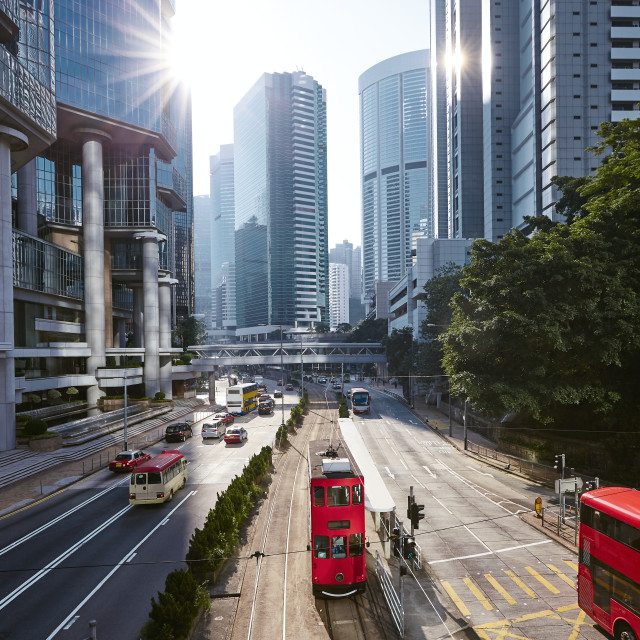 """Red double-decker tram on city street in Hong Kong"" stock image"