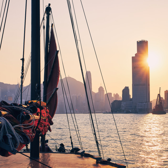 """Traditional Junk boat against Hong Kong cityscape"" stock image"