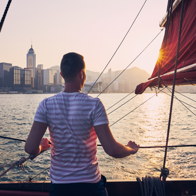 """Traveler on traditional junk boat"" stock image"