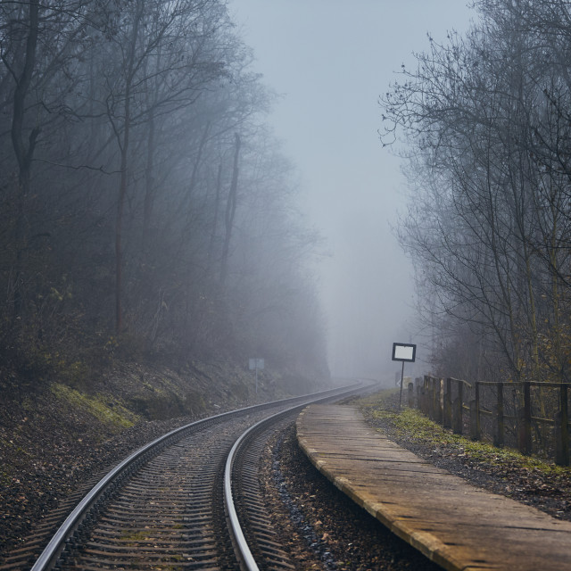 """Railway in mysterious fog"" stock image"