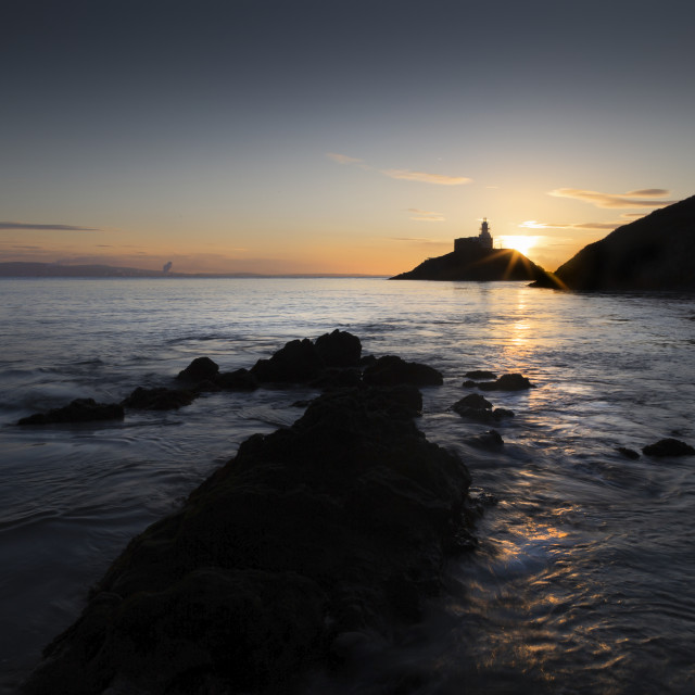 """Mumbles lighthouse at dawn"" stock image"