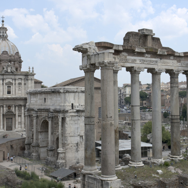 """Ruins of the Temple of Saturn, Arch of Septimius Severus and church of Saints Luke and Martina in the Roman forum"" stock image"