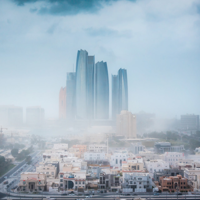 """""""Abu Dhabi during sandstorm and strong wings. View of the UAE cap"""" stock image"""