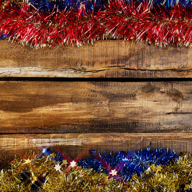 """Christmas frame tinsel decorations with copy space from wooden boards."" stock image"