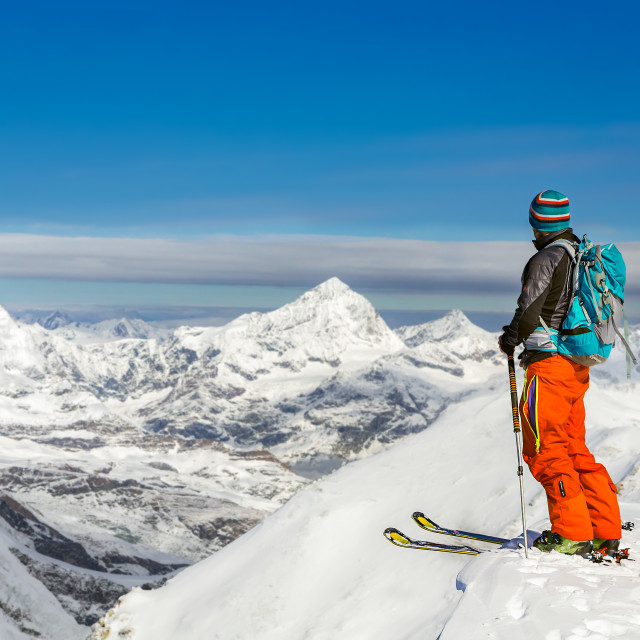 """Young athletic man skiing on a sunny day with beautiful view of"" stock image"