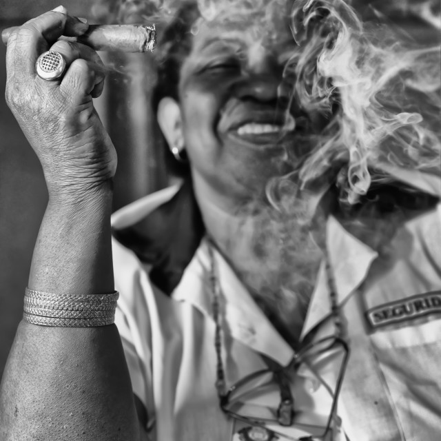 """WOMAN IN UNIFORM SMOKING CIGAR (CUBA)"" stock image"