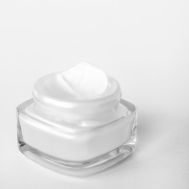 """Face cream moisturizer jar on white background, moisturizing skin care lotion..."" stock image"