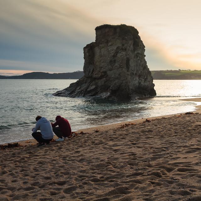 """Social Media Addicts At The Beach"" stock image"