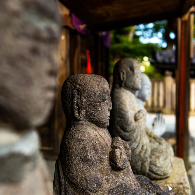 """Old Buddha Statues Lined Up in Japan"" stock image"
