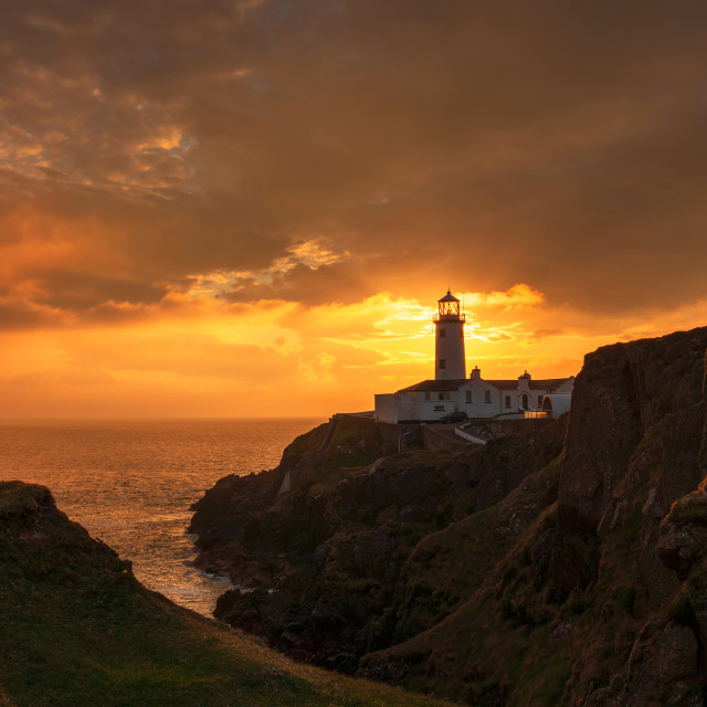 """Sunrise at Fanad Head lighthouse"" stock image"