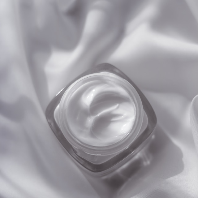 """Face cream moisturizer jar on silk background, moisturizing skin care lotion..."" stock image"