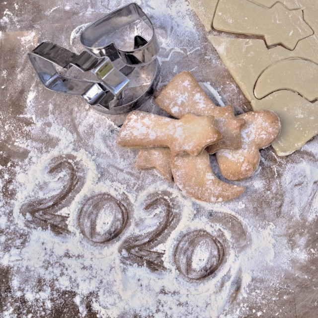 """""""2020 written in flour on a plank with homemade cookies"""" stock image"""