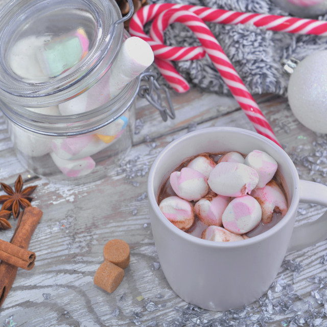 """mug full of marshmallows on a milk chocolate with spices and christmas decoration"" stock image"
