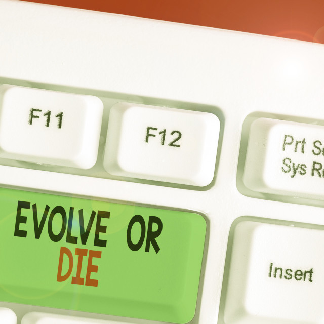 """""""Handwriting text writing Evolve Or Die. Concept meaning Necessity of change..."""" stock image"""