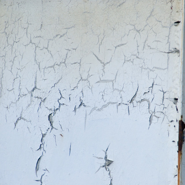 """Weathered metal panel with cracked peeling paint"" stock image"