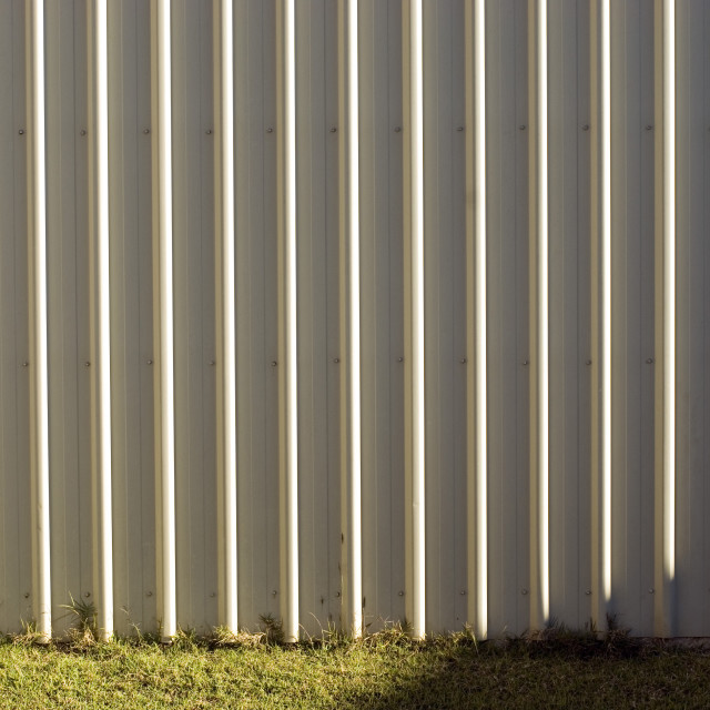 """Close up of cream coloured corrugated iron wall"" stock image"