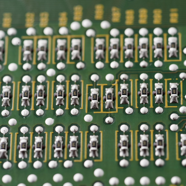 """Close up of resistors on electrical circuit board"" stock image"