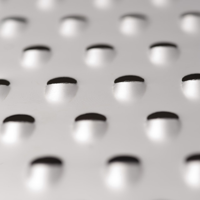 """Background texture of a steel grater"" stock image"