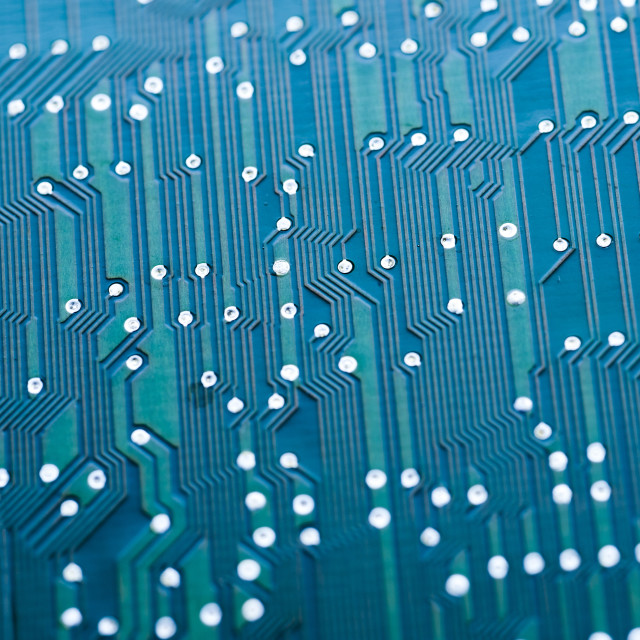 """Detail of wiring on blue, electrical circuit board"" stock image"