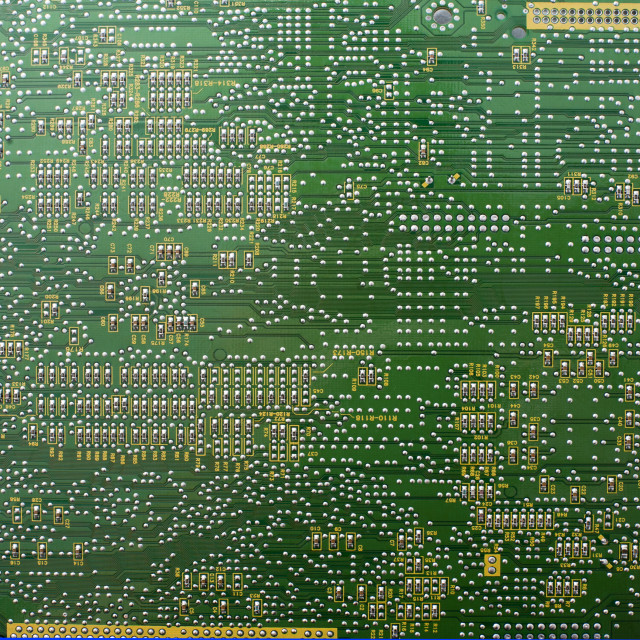 """Printed electronic circuit backdrop on green"" stock image"