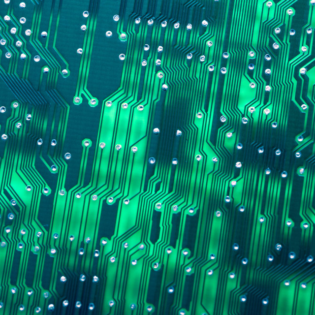 """Close up of a back lit circuit board and wiring"" stock image"