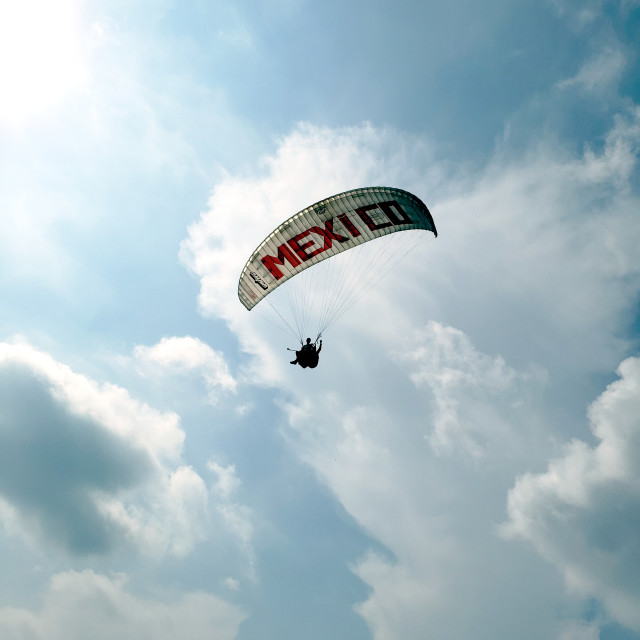 """""""Tandem paragliders with a parachute that says Mexico"""" stock image"""